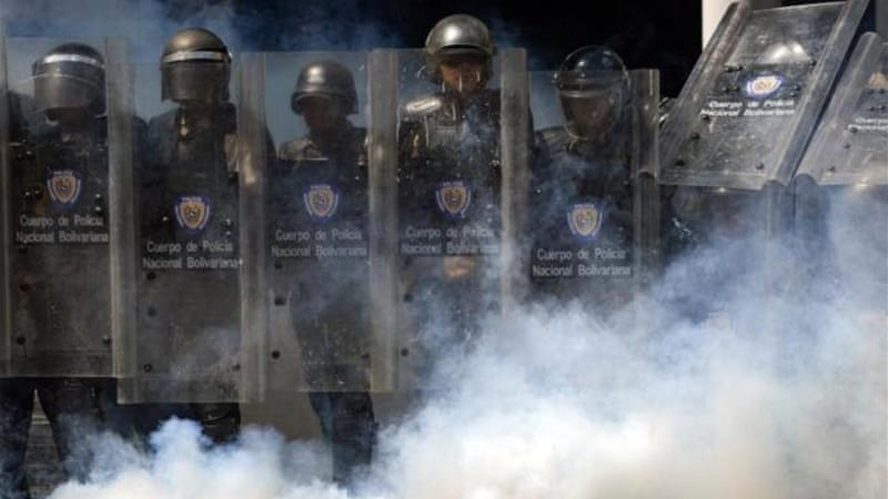 A group of protesters battled riot police in the capital, Caracas [AFP]