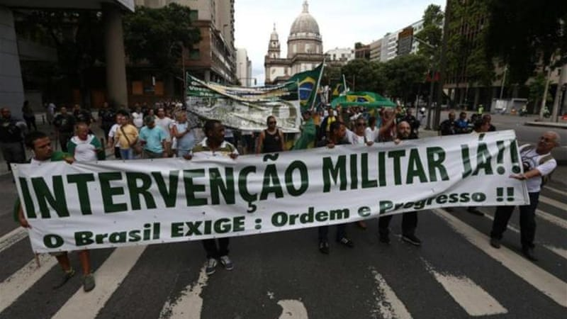 A group of supporters of Brazilian dictatorship march through Rio [AFP]