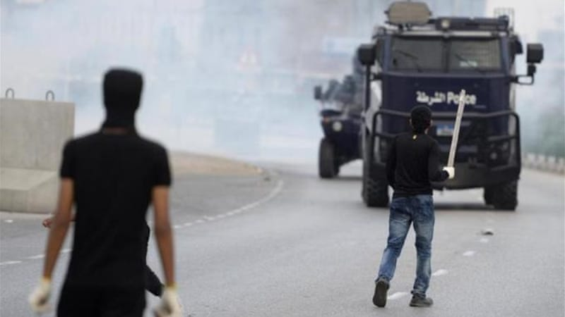 Protesters clash with a riot police during the protests [Reuters]