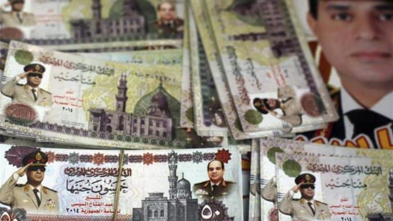 Sisi's image is ubiquitous in Cairo, including on fake Egyptian cash souvenirs on sale near Tahrir square [Reuters]