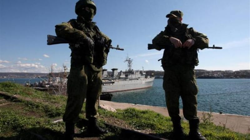 It is increasingly clear that the armed 'green men' in Crimea are Russian soldiers, writes the author [EPA]