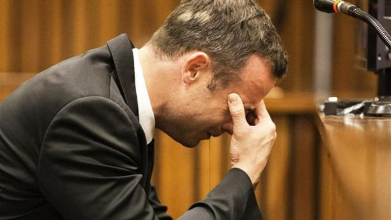 A neighbour said he found a distraught Pistorius kneeling over the body of Steenkamp [AP]