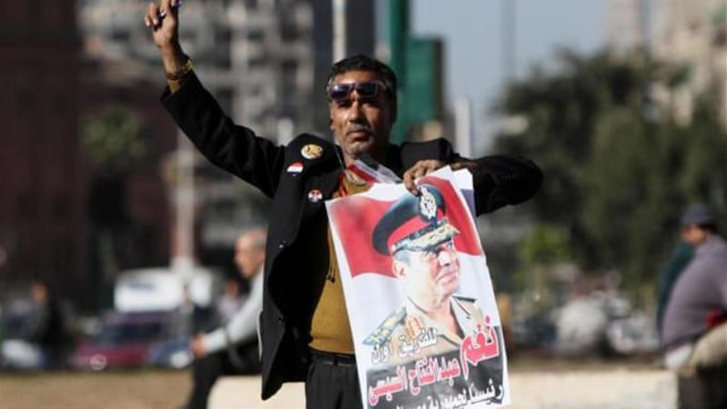 Egypt's powerful army chief Abdel Fattah el-Sisi is widely expected to win Egypt's presidential election [AFP]
