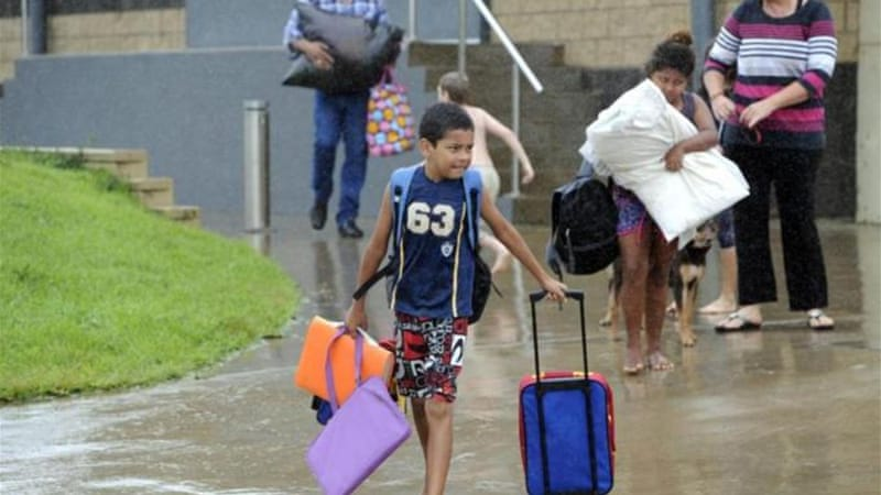 Families took shelter in evacuation centres in Cooktown, which bore the brunt of the storm [EPA]