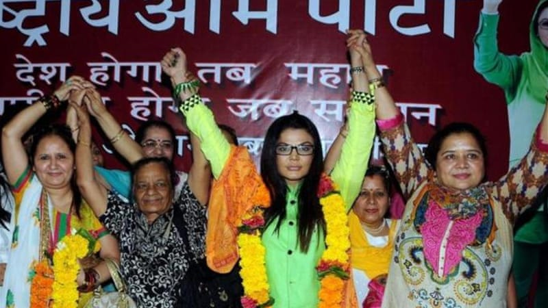 Indian actress Rakhi Sawant (third right) is running for the Mumbai North-West constituency on April 24 [AFP]