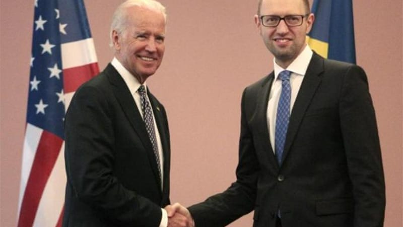 Biden and acting Ukraine prime minister, Arseniy Yatsenyuk, in Kiev [AP]