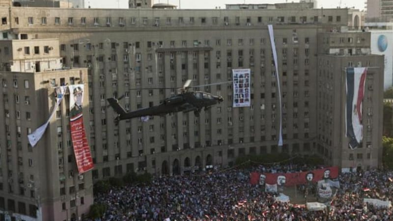 An Apache helicopter flies over Tahrir Square, Cairo, during pro-military protests last year [Getty]