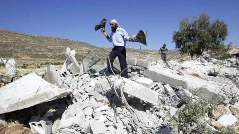 The mosque was among eight Palestinian buildings destroyed by Israeli troops in the West Bank village of Khirbet [AP]