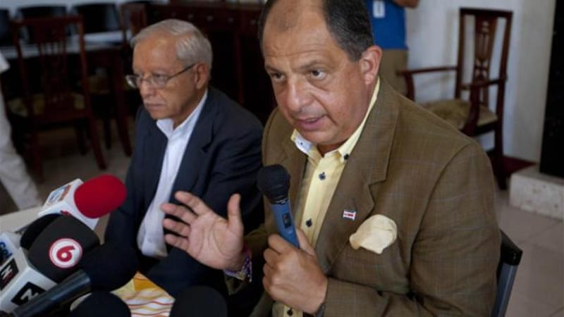 Luis Guillermo Solis was ranked a distant fourth by pollsters before the first round of voting in February  [AP]