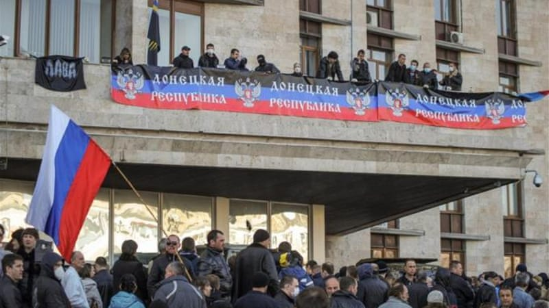 A pro-Russian crowd attacked the regional administration office in Donetsk and declared an 'independent Donetsk republic' [EPA]