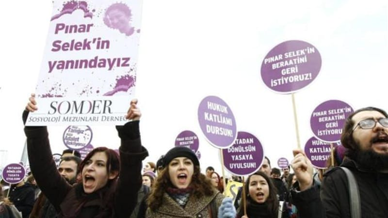 Turkish women hold placards reading: 'Justice for Pinar Selek' during a rally to support Turkish sociologist Pinar Selek in Istanbul [EPA]