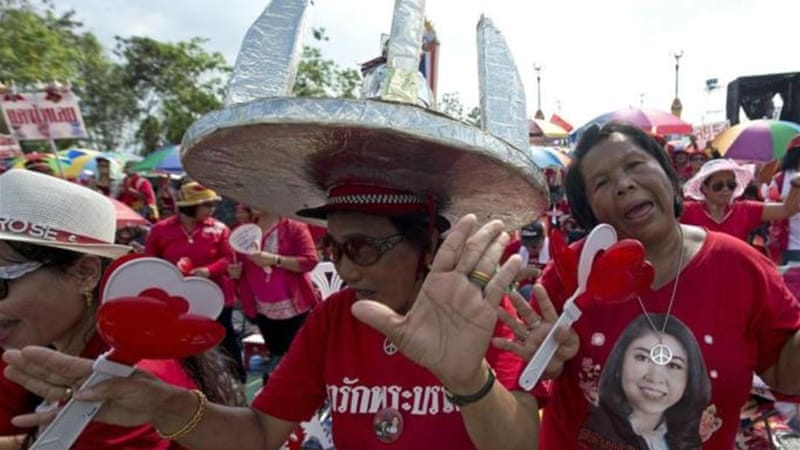 Thai pro-government Red Shirt protesters have warned against moves to install an unelected premier [AFP]