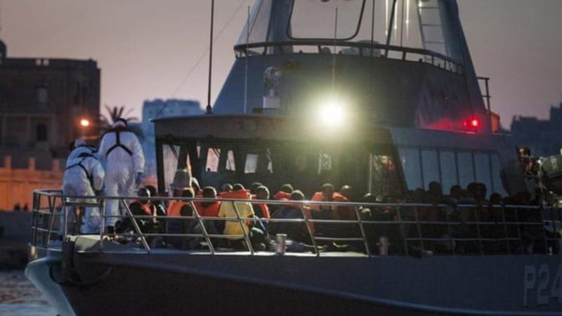 Migrants arrive onboard a Maltese armed forces vessel after being rescued at sea [EPA]