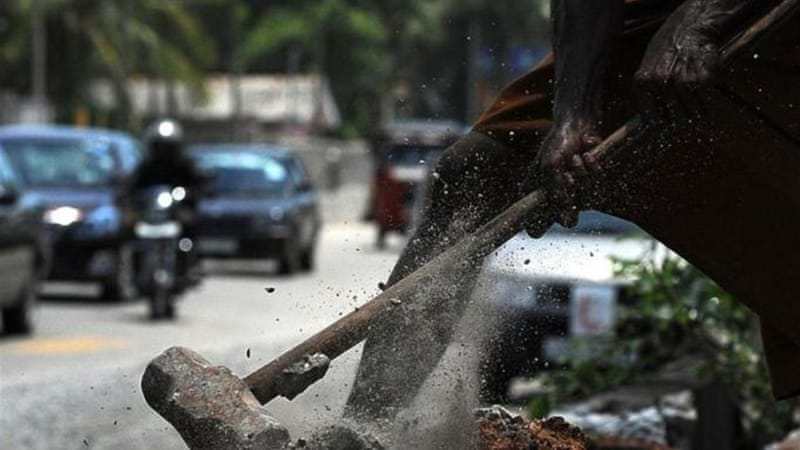 A Sri Lankan labourer works at a construction site in Colombo [AFP]