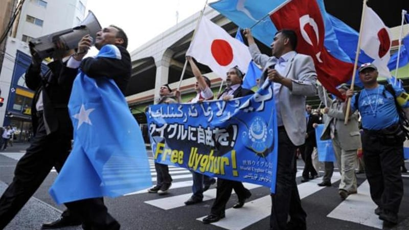 Uighur protesters in Tokyo shout slogans during a rally against Chinese government's policy in Xinjiang [EPA]