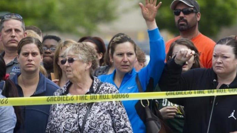 Parents of students at Reynolds High School wait to be reunited with their children after the shooting [Getty Images]