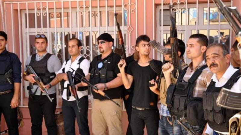 Heavily armed men gathered at the offices of the Iraqi Turkmen Front in Kirkuk [EPA]