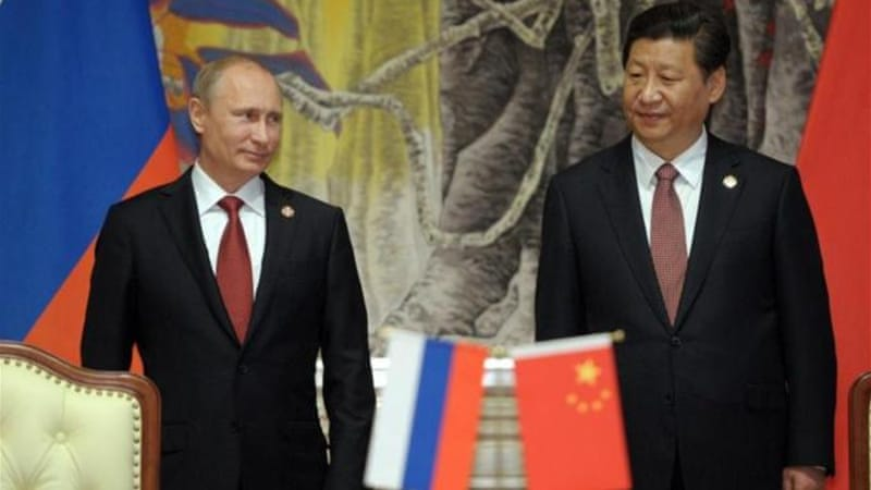 China's President Xi Jinping and Russia's President Vladimir Putin signed a multi-decade gas supply contract in Shanghai [AFP]