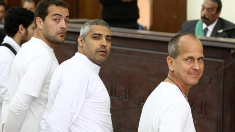 Three Al Jazeera journalists have been convicted and sentenced to serve at least seven years in detention, writes Cadman [EPA]