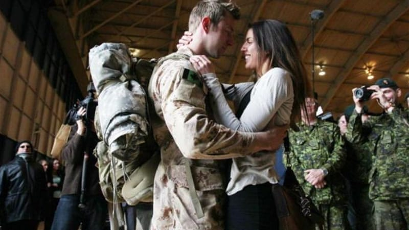 Canadian armed forces members were welcomed home, marking the end of Canada's participation in the Afghanistan war [AFP]