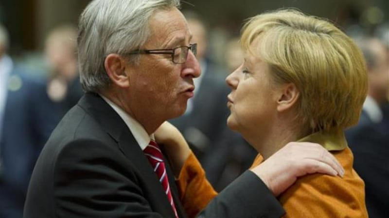 German Chancellor Merkel backed Juncker, left, for the European Commission president's post [AP]