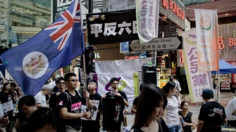 Many Hong Kong youth want China to hold true to its promise of 'one country, two systems' pledge [AFP]