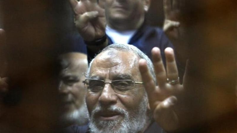 Mohamed Badie is being tried in nearly 40 cases and has already been sentenced to death in one case [AFP]