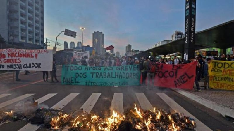 A Brazilian court has ordered the worker's union to pay a hefty fine for each day of the strike  [AFP]