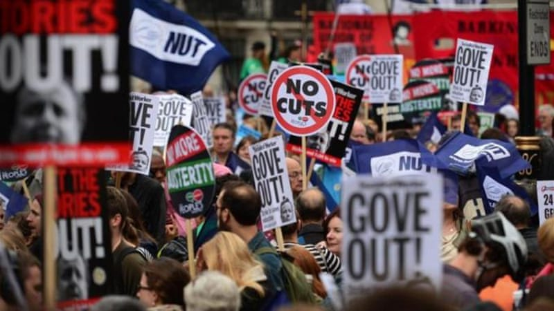 Hundreds of thousands of workers walked out in Britain over pay and austerity cuts [AFP]