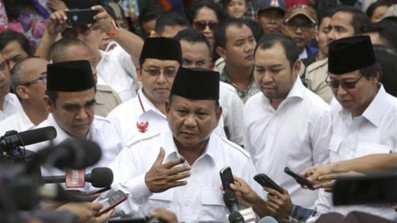Prabowo Subianto has claimed victory in Indonesia's presidential elections [AP]