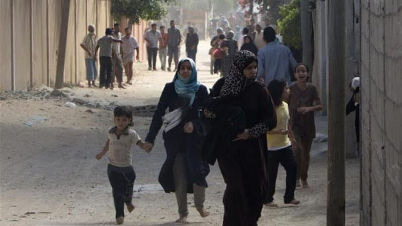 Palestinian families flee as Israel's army continues shelling Khan Yunis in the southern Gaza Strip [AFP]