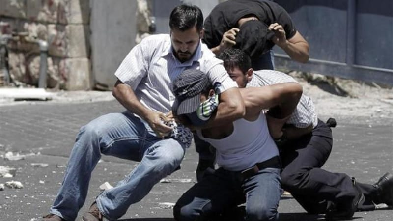 Israeli policemen arrest a Palestinian during clashes following Friday prayers in East Jerusalem [AFP]