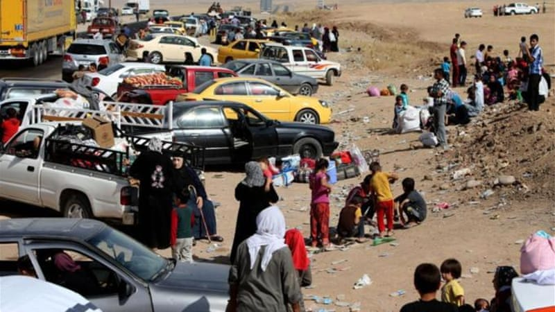 Thousands of Iraqis fleeing areas controlled by the Islamic State have been stranded at checkpoints [AP]