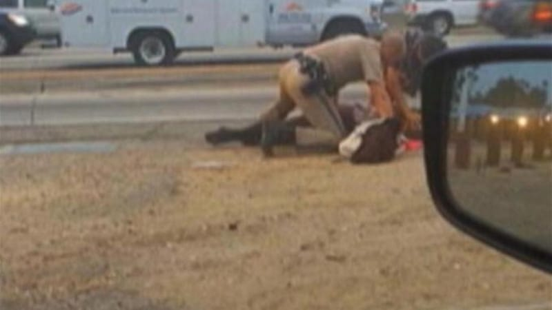 Police said the woman had been walking on the highway and the officer was trying to restrain her [AP]