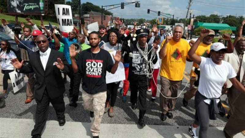 Protests were organised in the US town of Ferguson, Mo after the police shooting of Michael Brown. [AP]