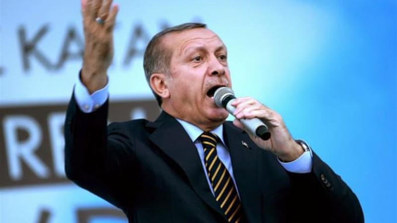 Turkish Prime Minister and presidential candidate of the ruling party in the August election, Recep Tayyip Erdogan addresses his supporters in Istanbul, Turkey, Friday July 25, 2014. (AP Photo/Emrah G