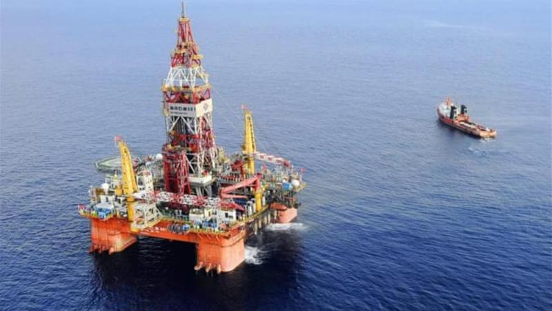 In Hanoi and other Asian capitals, Beijing's decision to relocate the Haiyang Shiyou oil rig 981 was met by a mixture of scepticism and relief, writes Heydarian  [AP]