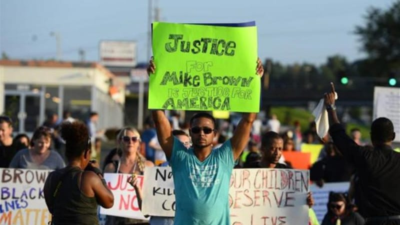 Police 'pacified' the protests over the shooting of Mike Brown in Ferguson in the same manner as they 'pacified' the riots in Brazil, writes Baboulias [EPA]