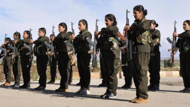 Kurdish female fighters of the Kurdish People's Protection Units (YPJ) at a military training camp. [Reuters]