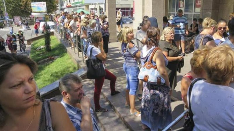 The people of Mariupol venture onto the streets, despite scepticism of a ceasefire holding [Reuters]