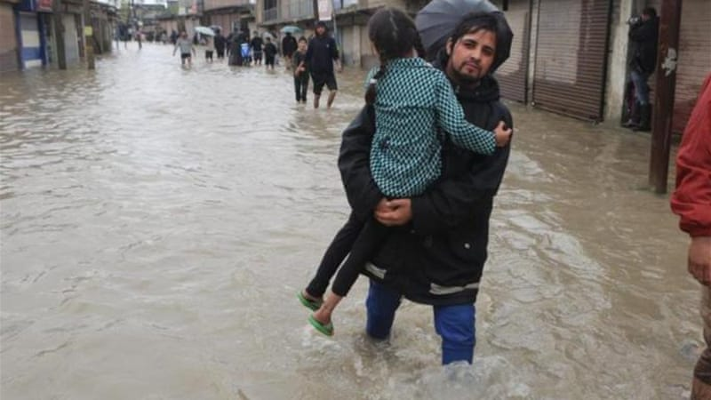 Officials say flood waters are moving too fast to allow boats to reach many people stranded in Srinagar [EPA]