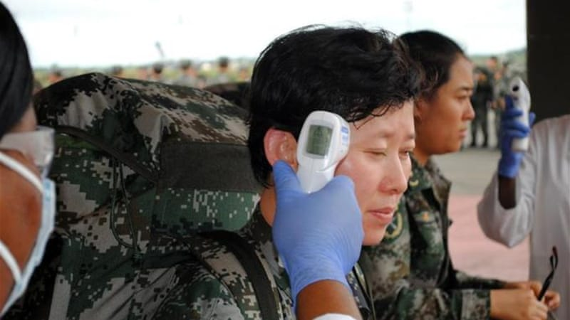 The 232-strong team will join Chinese army doctors already serving in West Africa [AFP]