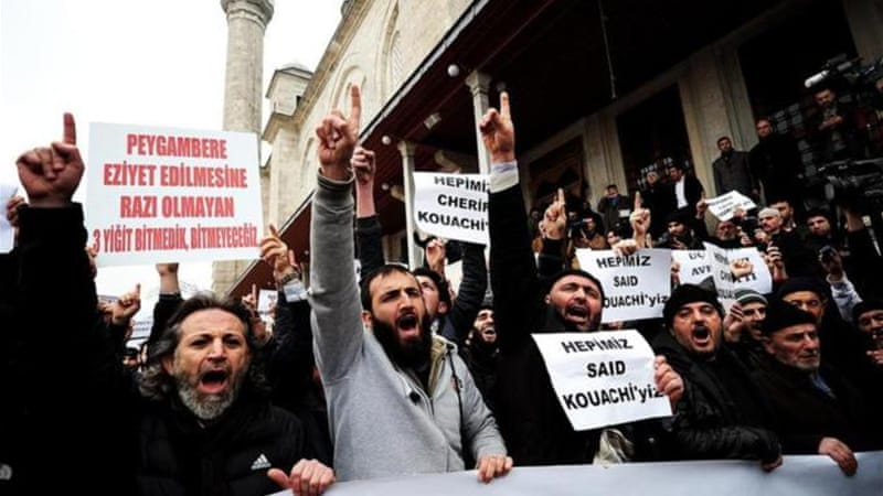 Turkish anti-Charlie Hebdo protesters shout slogans and hold placards reading 'We are all Kouachi' [AFP]