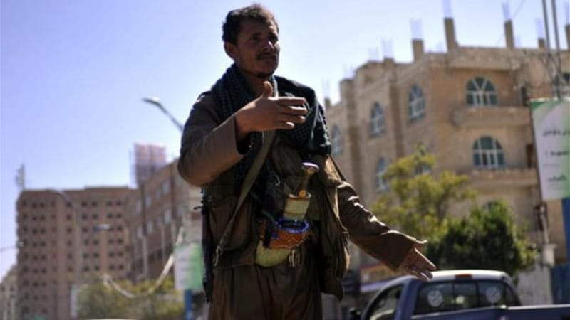 A Houthi fighter guards a street leading to the presidential palace in Sanaa [EPA]