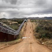 On the border, Trump's wall pledge casts long shadow