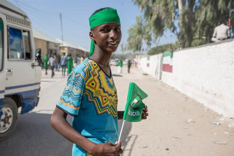 A boy on his way to join an UCID (Justice and Welfare Party) rally in Hargeisa. Young people in Somaliland have shown a strong interest in politics. 'The youth have energy, and for them politics is new,' says Abdirashid Aliahi Farah, a 26-year-old domestic election observer. 'Some are seeing their first election. In order to get their votes, all the parties say they have youth programmes and that they care about the young.' [Kate Stanworth/Saferworld/Al Jazeera]