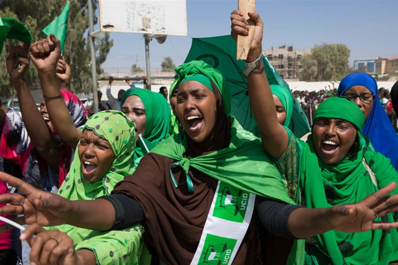 Women chanting and singing joyfully as they wait for their leader's address at an UCID rally in Hargeisa. [Kate Stanworth/Saferworld/Al Jazeera]
