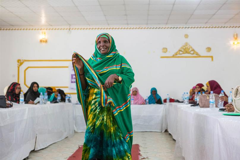 A woman speaks during a training session for female party campaigners in Guleid Hotel. 'We want people to vote for us without nepotism, and to campaign about positive change,' says Xakun Cali Daahir. [Kate Stanworth/Saferworld/Al Jazeera]