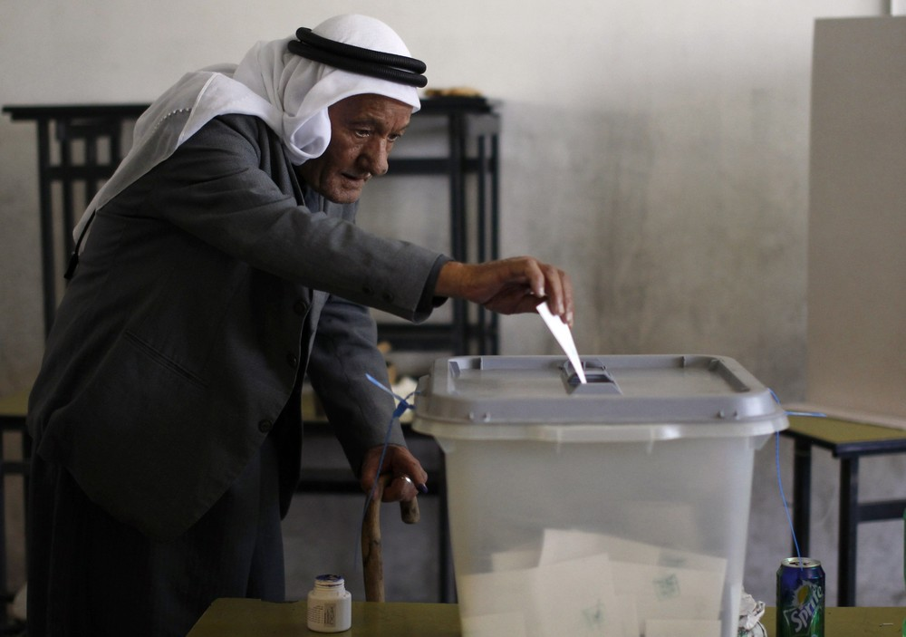 A Palestinian man casts his ballot for municipal elections at a polling station in the West Bank village of Shiyoukh, north of Hebron. Palestinians voted in local elections in the Israel-occupied West Bank on October 20.