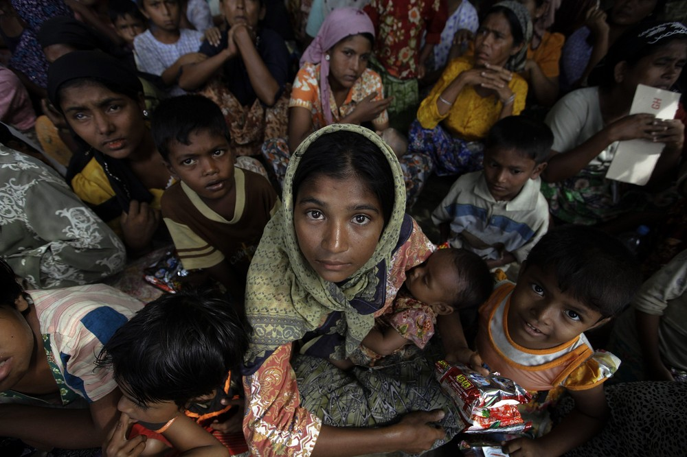 Boatloads of Rohingya Muslims struggled to reach refugee camps after a week of sectarian violence in Myanmar.